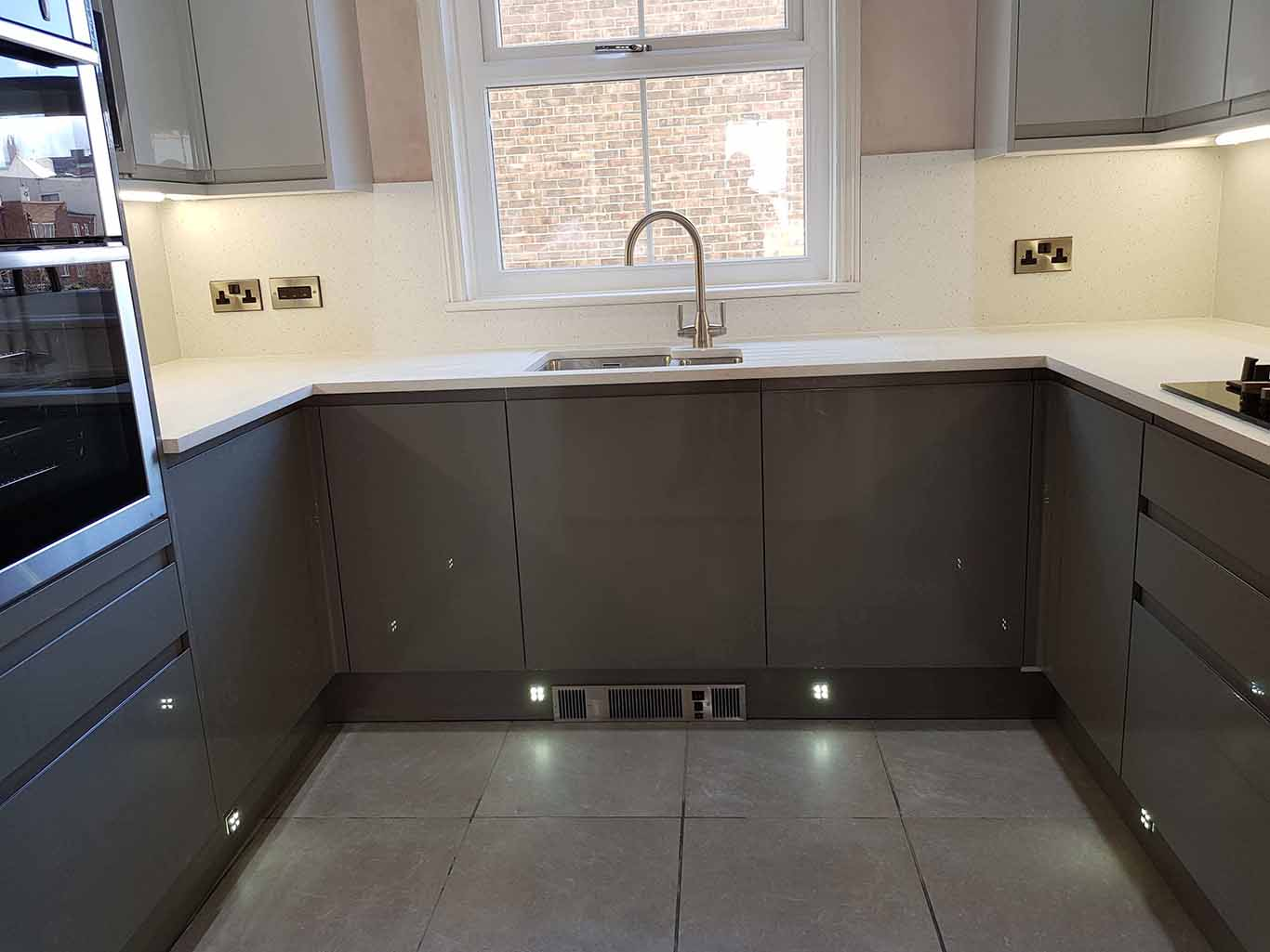 Charcoal Gloss kitchen with Minerva work tops